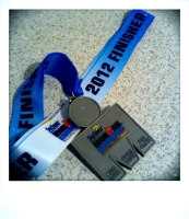 "This finisher medal will always be my ""number 13"" - weighted with much more than an Ironman finish!"